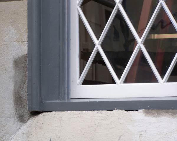 After image of same window, with smooth, clean paint lines